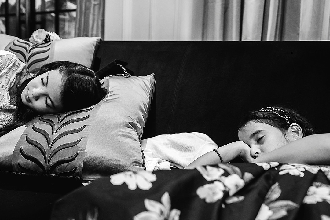 Corinthia Hotel Wedding Photographer tired children sleeping dueing the reception