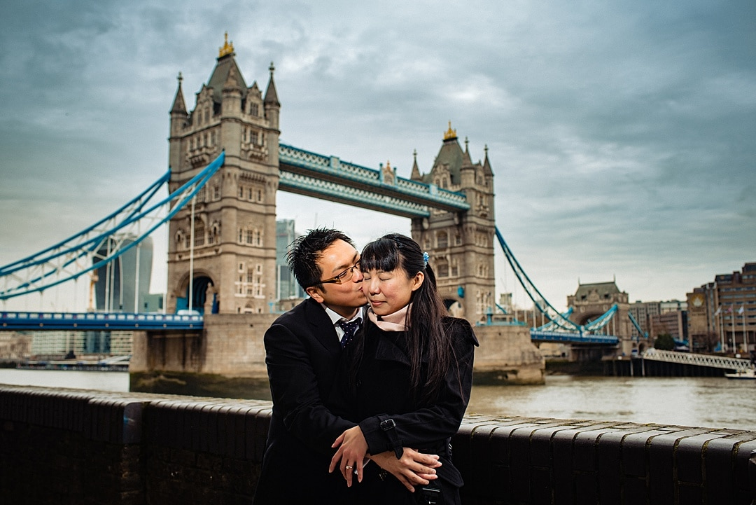 Winter London Engagement Photography Couple embracing near Tower Bridge London