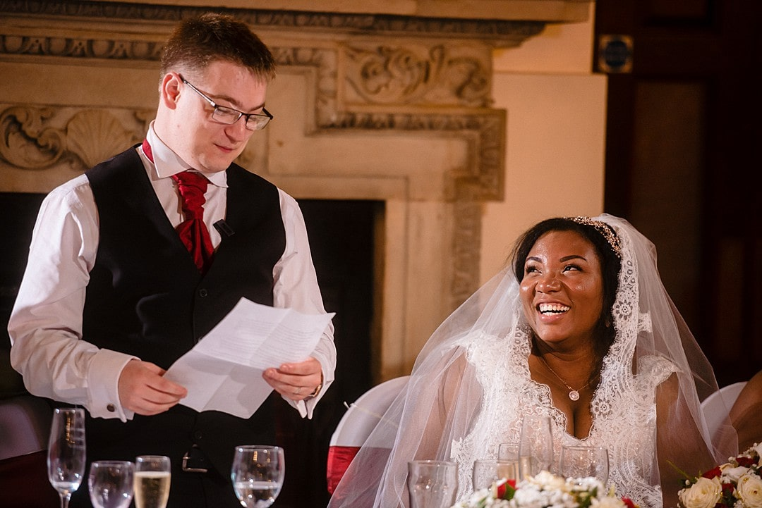 Dunston Hall Wedding Photography groom's speech and bride laughing