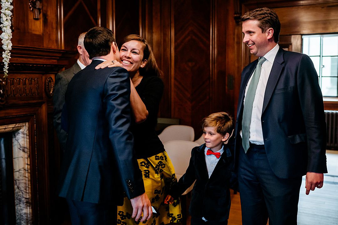 Marylebone Town Hall Wedding Photography hugs and kisses for the groom