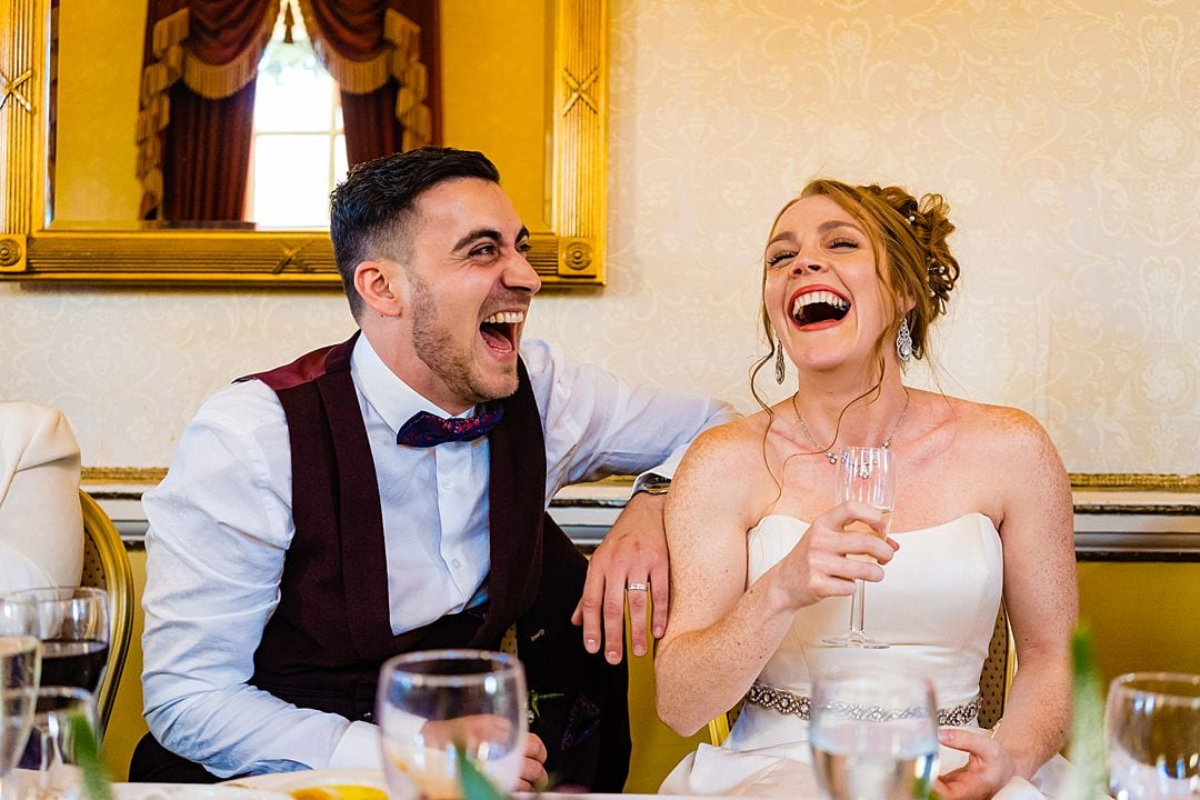 bride and groom laughter at Moor Park Mansion father of the bride's speech