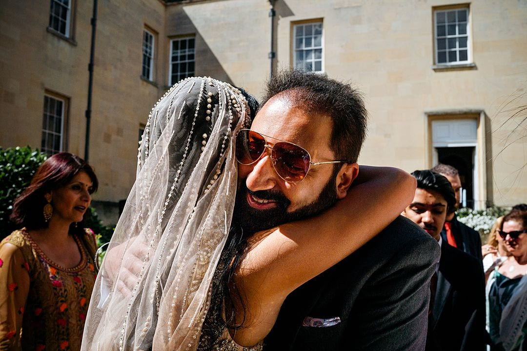 Syon Park Wedding Photography bride hugged by guest
