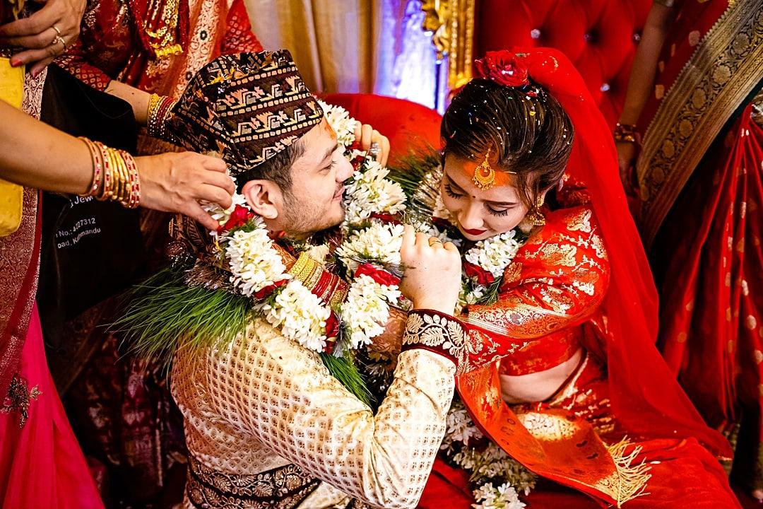 kathmandu wedding photography bride and groom exchanging garlands