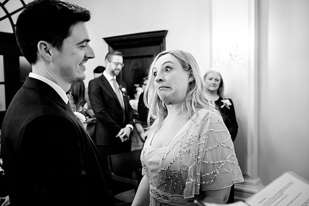 best wedding photography surrey 2019 bride pulling a face during the wedding ceremony at old chelsea town hall